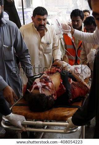 PESHAWAR, PAKISTAN - APR 19: Injured victims of bomb explosion that occurred outside Excise and Taxation government office building in Mardan, on April 19, 2016 in Peshawar.