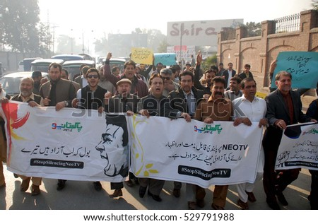 PESHAWAR, PAKISTAN - DEC 05: Members of Khyber Union of Journalists (KHUJ) against (PEMRA) during protest rally at Sher Shah Suri Road on December 05, 2016 in Peshawar.
