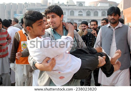 PESHAWAR, PAKISTAN - DEC 16: Victims of militants attacked an Army Public School  situated on Warsak Road, being shifted for treatment at local hospital on December 16, 2014 in Peshawar.