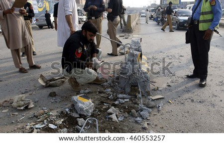 PESHAWAR, PAKISTAN - JUL 29: Bomb disposal squad personnel are collecting evidence from site after blast at Charsadda bus stand on July 29, 2016 in Peshawar.