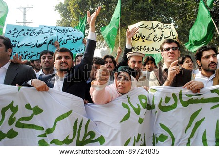 PESHAWAR, PAKISTAN - NOV 28: Supporters of Muslim League-Q shout slogans in favor of Pak Army during protest demonstration against NATO attack, on November 28, 2011in Peshawar.