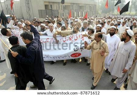 PESHAWAR, PAKISTAN - NOV 01: Supporters of WAPDA Hydro Electric Central Labor Union are protesting in favor of their demands during demonstration on November 01, 2011 in Peshawar, Pakistan - stock photo