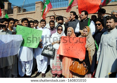 PESHAWAR, PAKISTAN - OCT 31: Activists of Tehreek-e-Insaf (PTI) chant slogans against electricity load shedding during protest demonstration at  press club on October 31, 2013 in Peshawar.