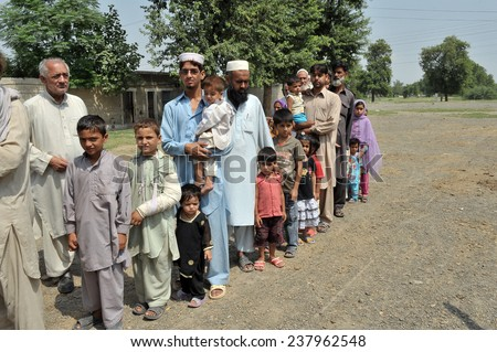 PESHAWAR, PAKISTAN - SEPT 09: Flood victims assistance  Peshawar, Pakistan on September 09, 2010. - stock photo