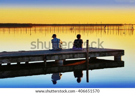 pesons in the lake - stock photo