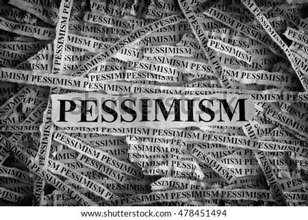 Pessimism. Torn pieces of paper with the word Pessimism. Concept Image. Black and White. Closeup.