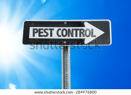 Pest Control direction sign with a beautiful day - stock photo
