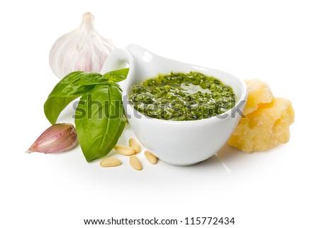 Pesto Genovese in a gravy boat and ingredients - stock photo