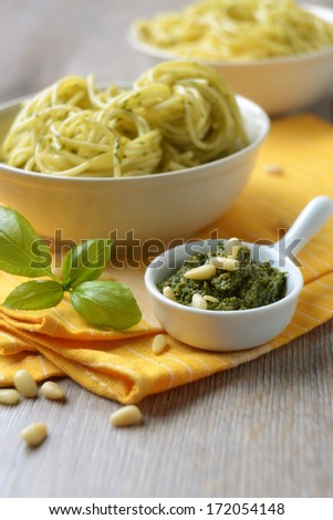 pesto genovese with spaghetti behind - stock photo
