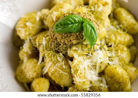 pesto gnocchi on dish close up - stock photo