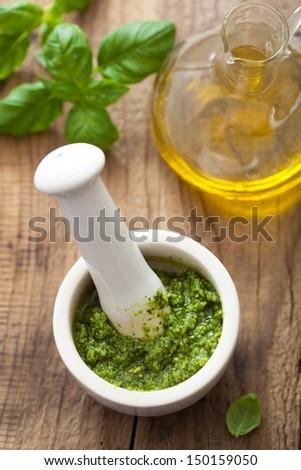 pesto sauce in mortar  - stock photo