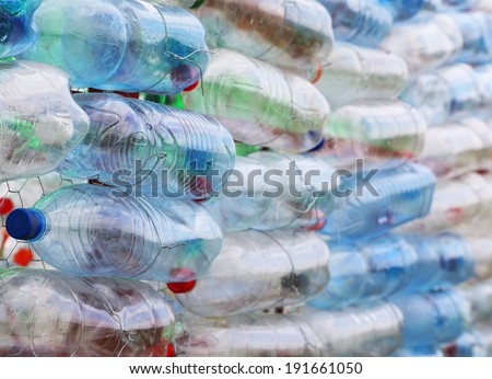 Pet bottles - abstract wall - stock photo