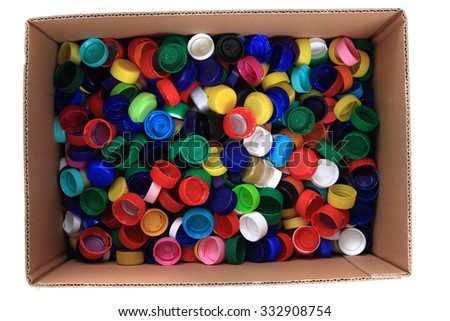 pet caps in the paper box isolated on the white background - stock photo