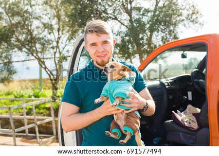 pet, domestic animal, season and people concept - Portrait of happy man with his chihuahua dog walking outdoors