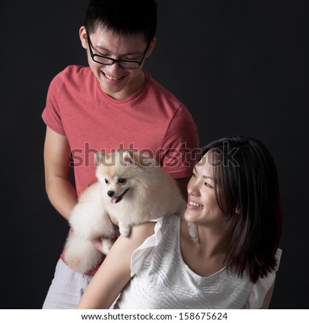 Pet owners bonding with their dog - stock photo
