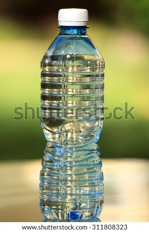 PET (PETE Polyethylene Terephthalate) water bottle. Shallow depth of field. Nice bokeh.