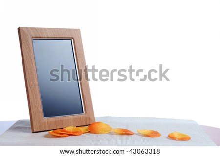 petal and  photoframe on the table in white background - stock photo