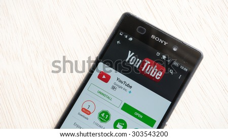 Petaling Jaya, Malaysia - Aug 6, 2015: Youtube Mobile app in Google Play Store on mobile phone. YouTube Mobile was launched in June 2007, using RTSP streaming for the video. - stock photo