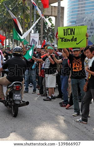 PETALING JAYA, MALAYSIA - MAY 25: Protester at the demonstration rally against alleged electoral fraud in the Malaysia 13th general election on May 25, 2013 in Padang Timur, Petaling Jaya, Malaysia.