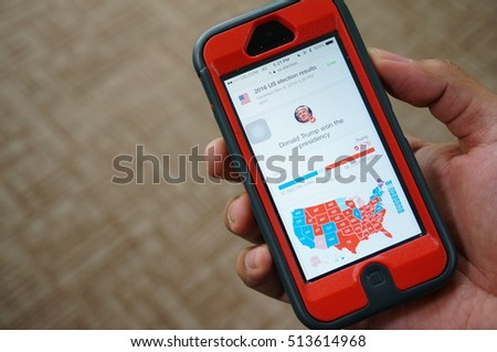PETALING JAYA, MALAYSIA-NOV 9 : Hand holding the Apple iPhone SE and reading about US President Elections result in Petaling Jaya on Nov. 9, 2016. Donald Trump won the presidency.