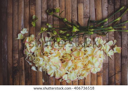 petals flowers hart frame in form of   flower on brown wood board  background in rustic style for wedding decoration