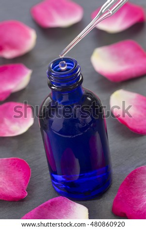 Petals of roses and Bottles  Essential Oil for Aromatherapy