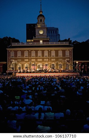 Peter Nero and the Philly Pops performing in front of historic Independence Hall, Philadelphia, Pennsylvania on July 3, 2011 - stock photo
