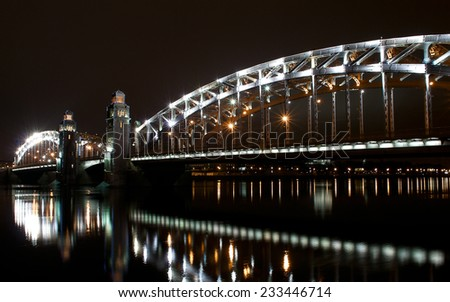 Peter the Great Bridge on the Neva River in Saint Petersburg at night before New Year - stock photo