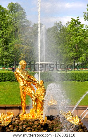 PETERGOF, RUSSIA - MAY 27, 2013: Samson Fountain of the Grand Cascade in Peterhof Palace. - stock photo