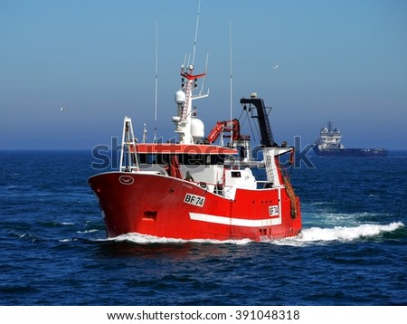 Peterhead, Scotland, 10th of June 2014, Fishing boat underway at sea to discharge fish at harbor. - stock photo