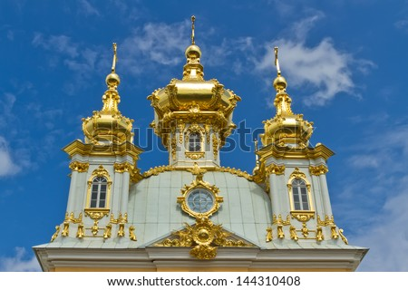 Peterhof Grand Palace against blue sky. Golden church, Peterhof, Russia - stock photo