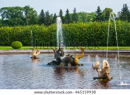 Peterhof Palace St Petersburg, Russia. Golden fish statue fountain in Higher Park. The Peterhof Palace included in the Unesco'S World Heritage list