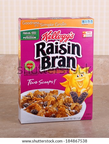 PETERSBURG, ILLINOIS-MARCH 26, 2014:  Box of Kellogg's Raisin Bran on a kitchen counter.  Kellogg's is an American multinational manufacturer of cereal and convenience foods. - stock photo