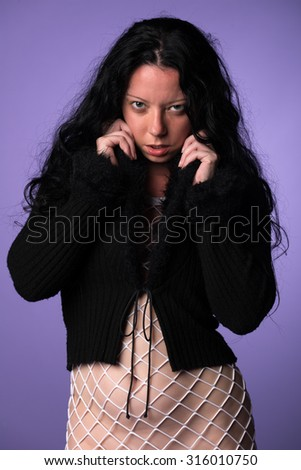 Petite Italian brunette in a fuzzy black sweater and white fishnet dress