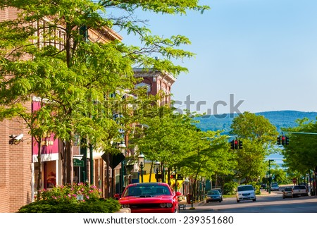 PETOSKEY, MI - JUNE 27, 2014: The view to the north down Howard St affords a glimpse of Little Traverse Bay off Lake Michigan, a setting that makes this quaint town a popular coastal resort. - stock photo