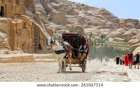 PETRA, JORDAN- APRIL 09, 2014: Tourist transport (carriage) in Petra,  Jordan-- it is a symbol of Jordan, as well as Jordan's most-visited tourist attraction  - stock photo