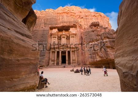 PETRA, JORDAN - OCT 12, 2014: The treasury or Al Khazna, it is the most magnificant and famous facade in Petra Jordan, it is 40 meters high, 2014 in Jordan - stock photo