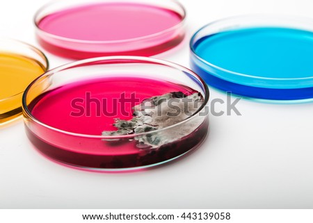 Petri dish with mold on white, selective focus. - stock photo