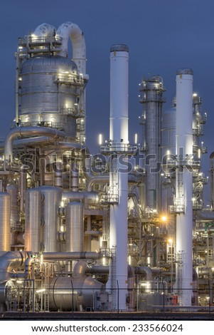 Petrochemical factory at night. - stock photo