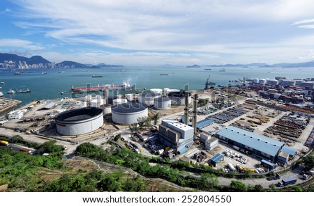 petrochemical industrial plant under blue sky, hong kong day - stock photo
