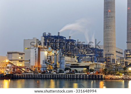 petrochemical industry on sunset, hong kong - stock photo