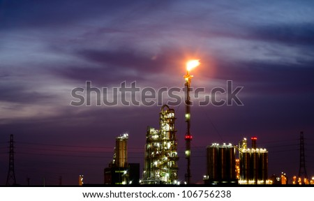 Petrochemical plant and flare at twilight time - stock photo