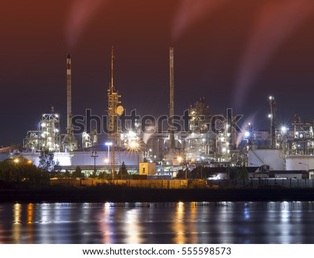 petrochemical plant at night with abstract orange sky added on image