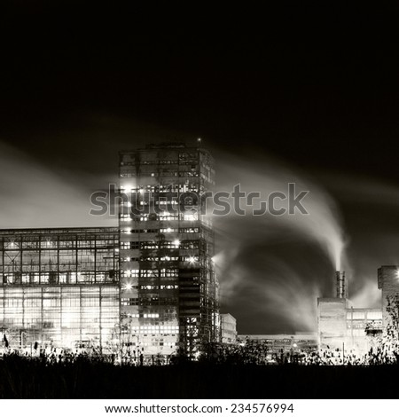 Petrochemical plant in night. Long exposure, monochrome photography  - stock photo