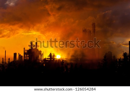 petrochemical plant in silhouette - stock photo
