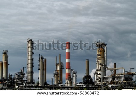 Petrochemical processing facility in Edmonton Alberta, Canada.  This refinery site has been in use since the 1940's.  Light and background for this photo are natural and unaltered - stock photo