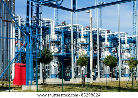 petrochemical refinery pipes and tanks in a factory - stock photo
