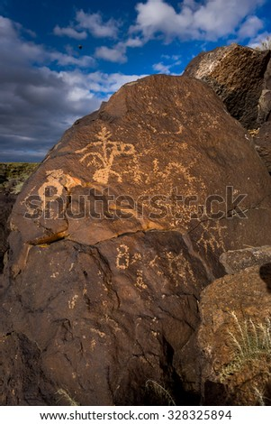 Petroglyphs carved in a large boulder outside Albuquerque, NM - stock photo