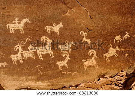 Petroglyphs (rock art) at the Wolfe Ranch in Arches National Park, Utah - stock photo