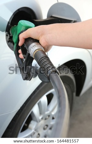 Petrol or gasoline being pumped into a motor vehicle car